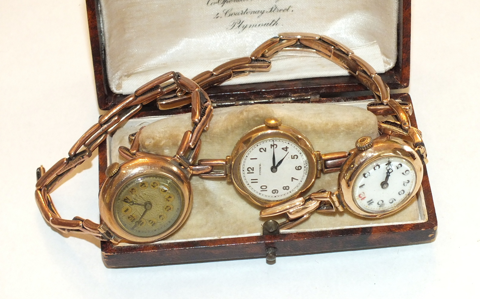 Lot 235 - Three ladies wrist watches with 9ct gold cases and sprung bracelets, gross weight 52g, (3).