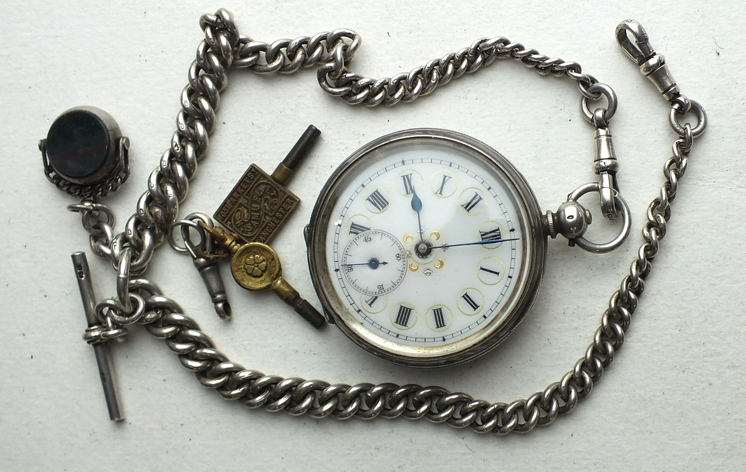 Lot 257 - A silver-cased open-face key-wind pocket watch, the white enamel dial with Roman numerals and