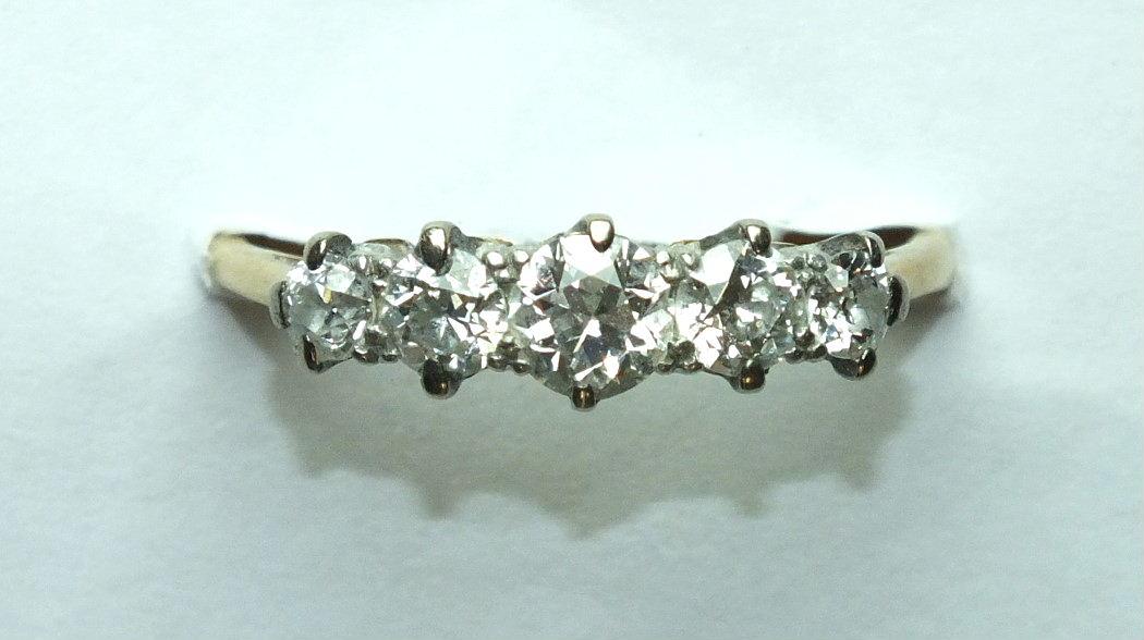 A five-stone diamond ring claw-set five graduated old brilliant-cut diamonds, in 18t gold mount,