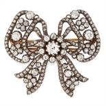 AN ANTIQUE DIAMOND BOW BROOCH, CARTIER LATE 19TH CENTURY in 18ct yellow gold and silver, designed as