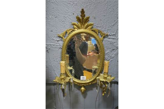 A Pair Of Victorian Style Oval Wall Mounted Girandole Mirrors The