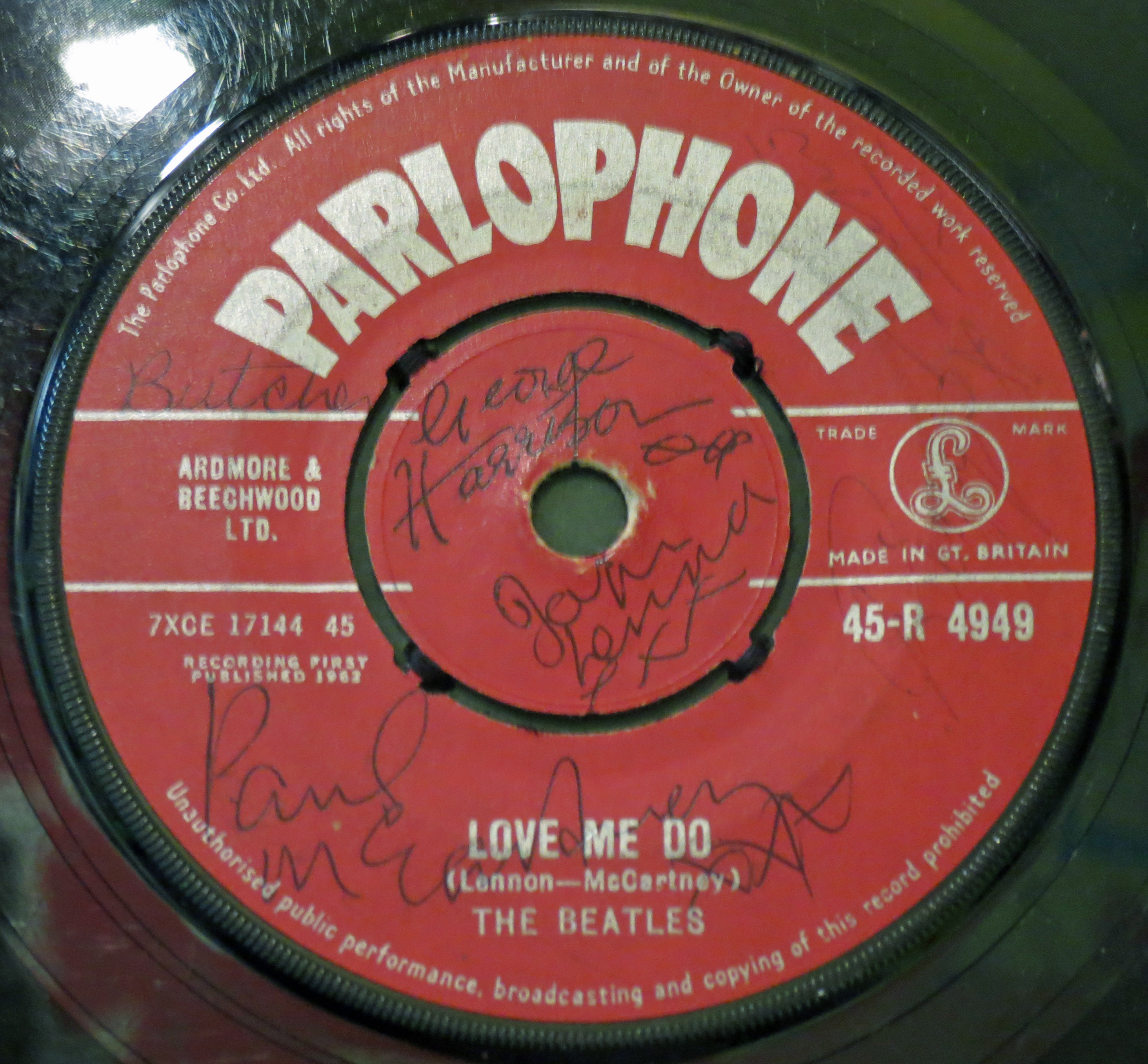 The Beatles Love Me Do single signed at Dawsons Record Shop, Widnes on 6th October 1962. The