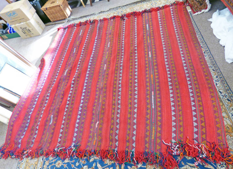 RED GROUND MIDDLE EASTERN CARPET WITH STRIPED GEOMETRIC DESIGN 245 X 225CM