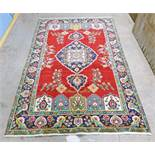 HAND WOVEN RED GROUND PERSIAN TABRIZ RUG WITH A UNIQUE MEDALLION DESIGN AND BESPOKE PATTERN 310 X
