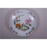 A Chinese polychrome enamel porcelain dish with frilled rim, decorated with peonies and prunus