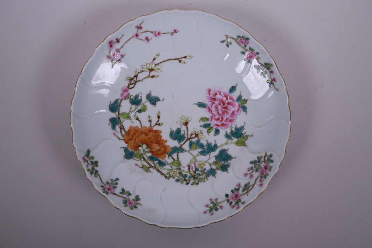 Lot 5 - A Chinese polychrome enamel porcelain dish with frilled rim, decorated with peonies and prunus
