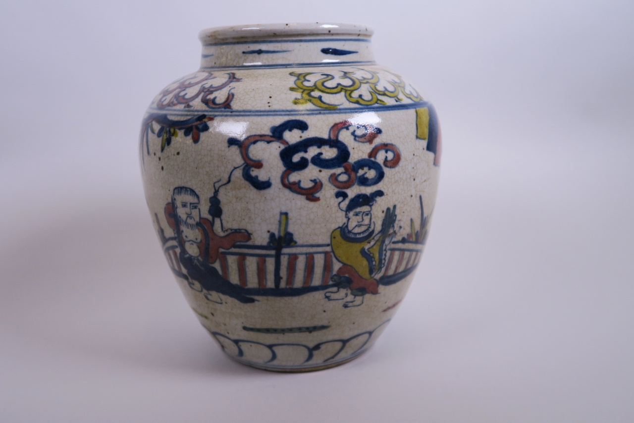 "Lot 13 - A Chinese crackle ground vase with wucai decoration of immortals, 8"" high"