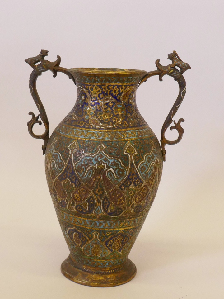 """Lot 36 - A Kashmiri gilt brass and enamel vase, with dragon handles, probably late C19th, 13"""" high"""