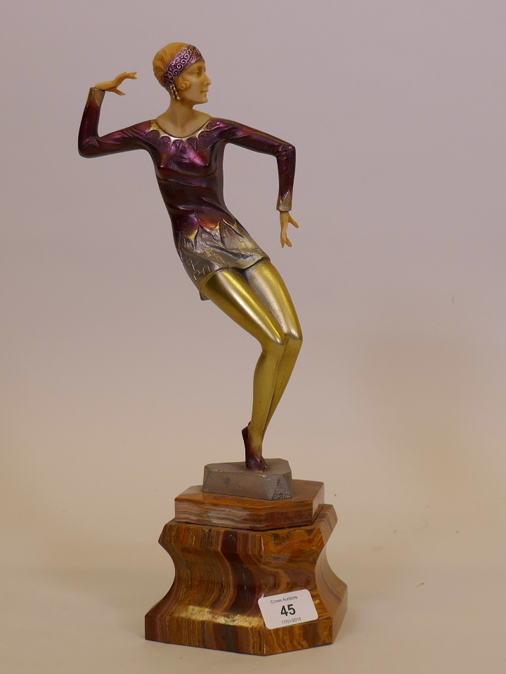 Lot 45 - A contemporary Art Deco style figure after Preiss, the Charleston Dancer, mounted on a serpentine