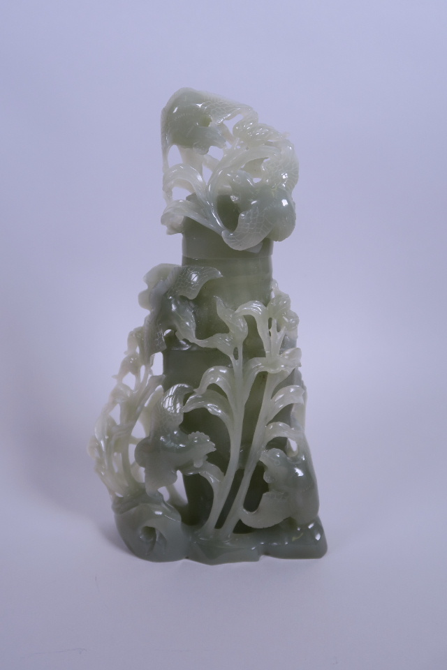 """Lot 50 - A Chinese carved celadon jade jar and cover with cockerel decoration, 9"""" high"""