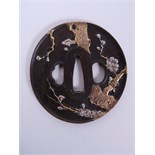 "A Japanese bronze tsuba with raised cherry tree decoration, 3"", with character inscription"