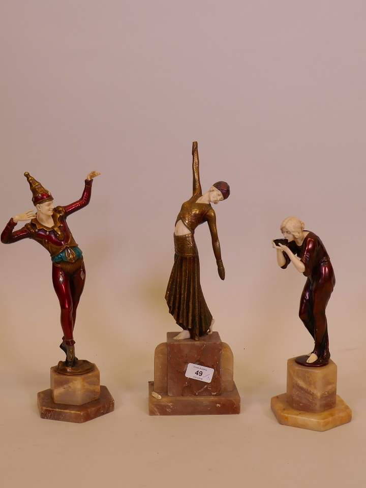 """Lot 49 - A contemporary Art Deco figurine of Pierrot mounted on an alabaster base, 14"""" high, another of women"""
