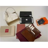 A Piquadro Nikolai leather wallet, in original case, a Cole and Haan cream fur clutch bag, a