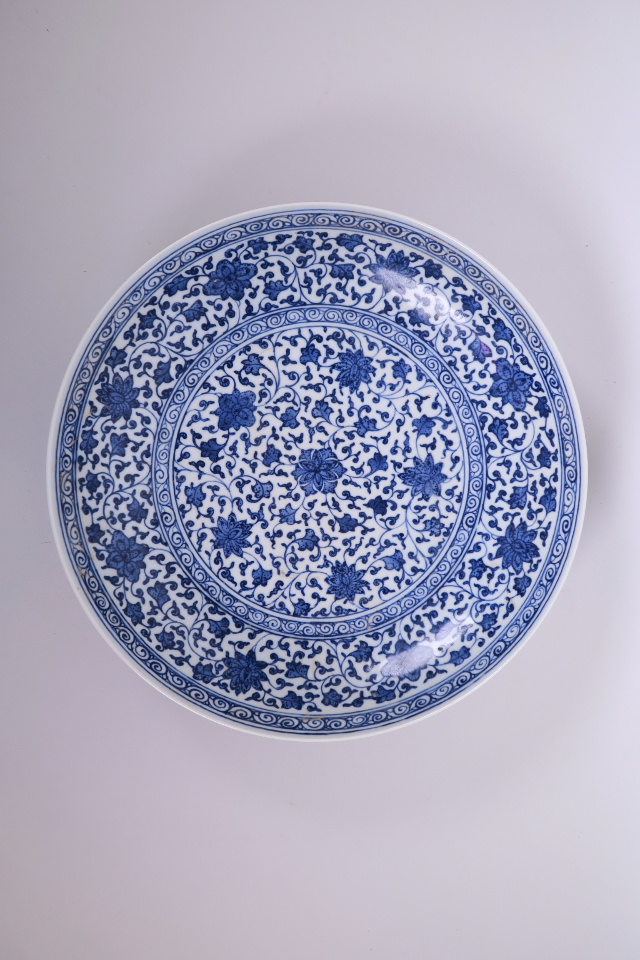 """Lot 25 - A Chinese blue and white porcelain charger with scrolling floral decoration, 12"""" diameter, seal mark"""
