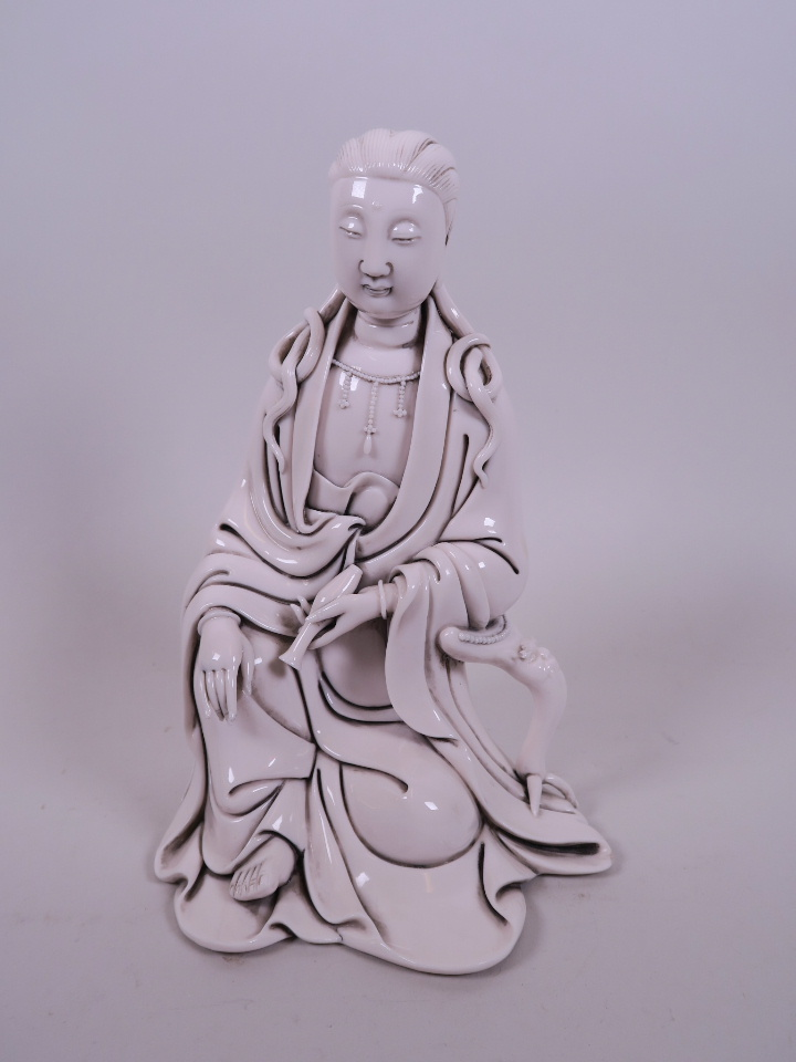 "Lot 52 - A Chinese blanc de Chine figure of Quan Yin, impressed seal mark verso, 8"" high"