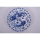 A Chinese blue and white porcelain dish with lobed rim, decorated with a dragon and phoenix