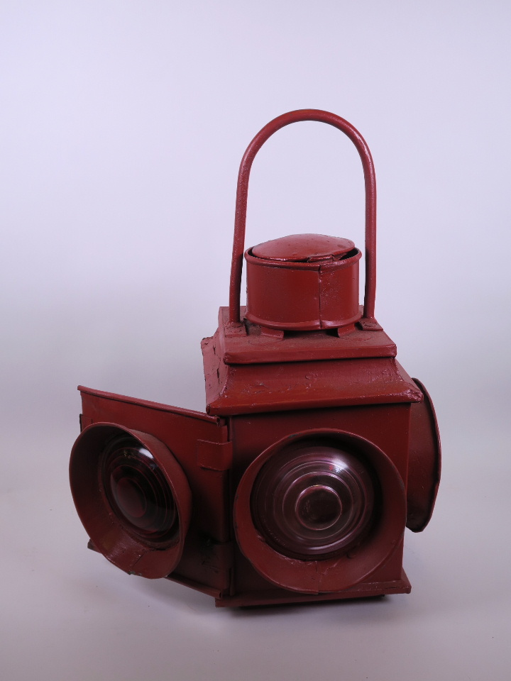 "Lot 19 - A mid C20th signalman's lamp, 21½"" high"