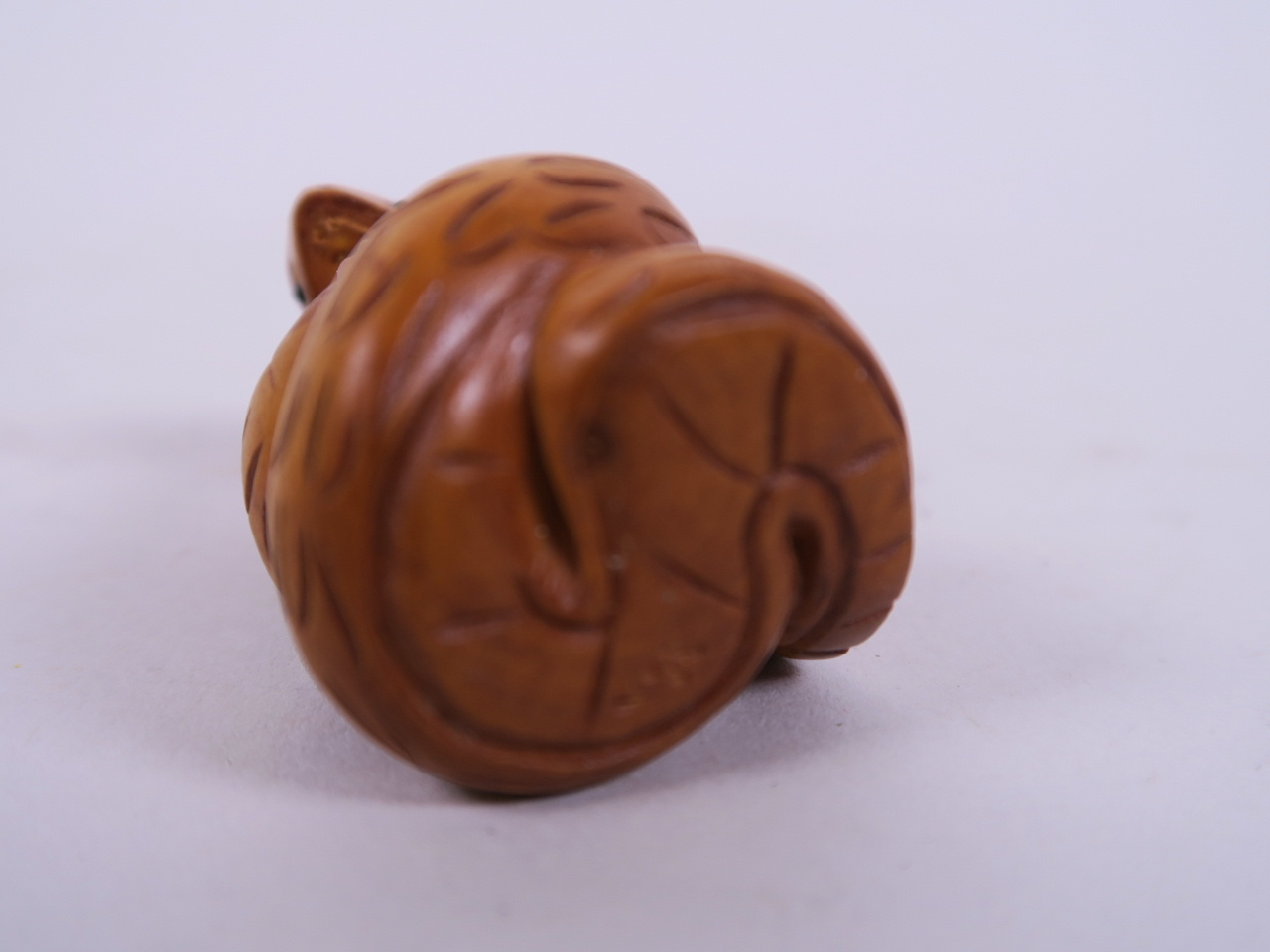 "Lot 17 - A Japanese carved hardwood netsuke in the form of a cobra, 2"" long"