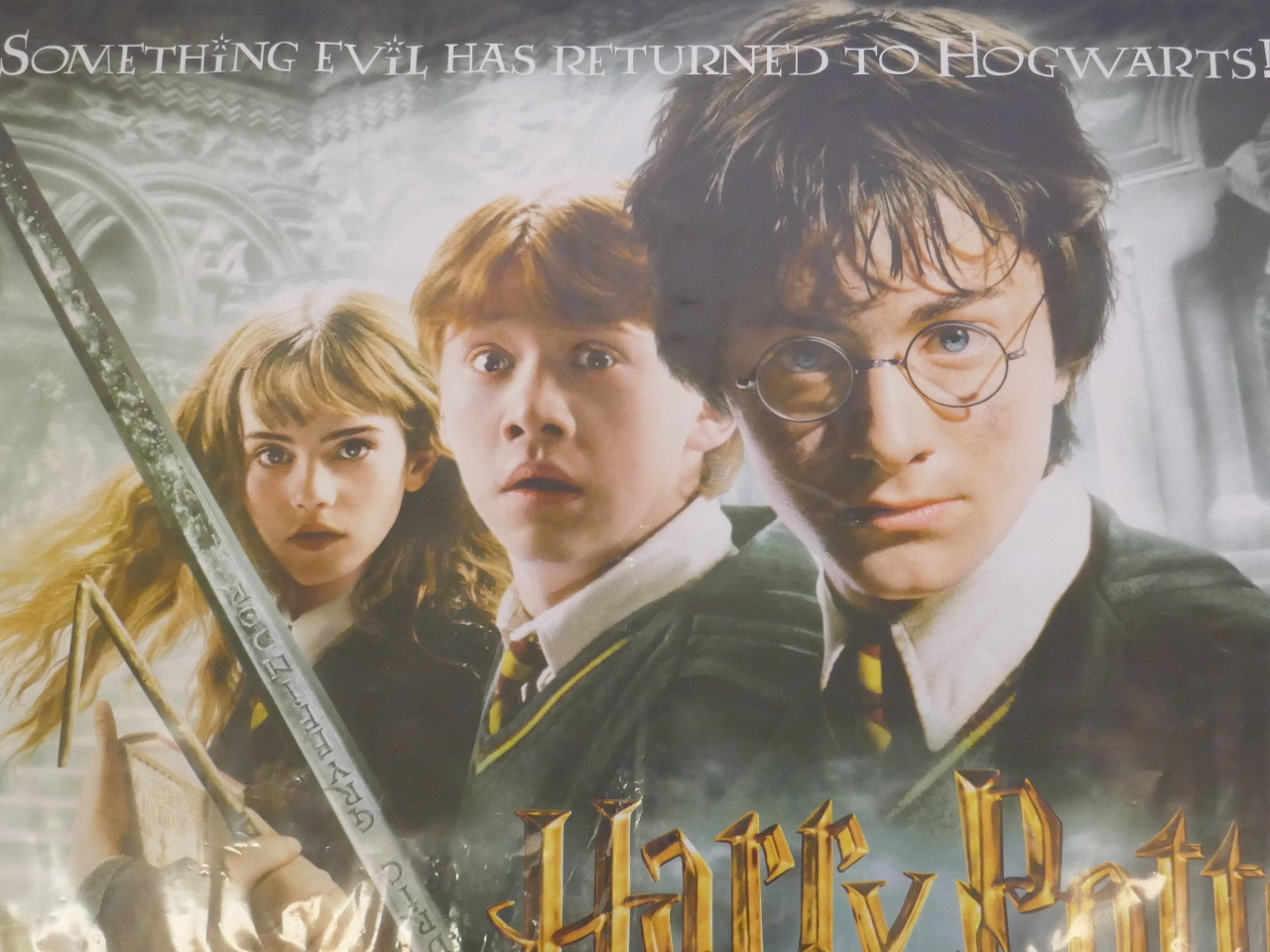 "Lot 12 - An original, unfolded quad film poster for 'Harry Potter and The Chamber of Secrets', 40"" x 30"""