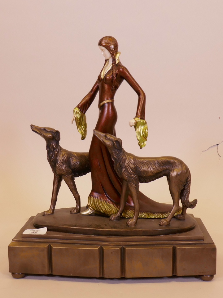 """Lot 42 - A contemporary Art Deco style figure after O. Poertzal, 'The Aristocrats', 16"""" high"""
