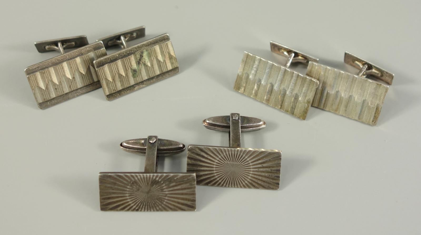 3 Paar Manschettenköpfe, 835er Silber, Gew.28,55g, recheckige Platten mit unterschiedlichen,