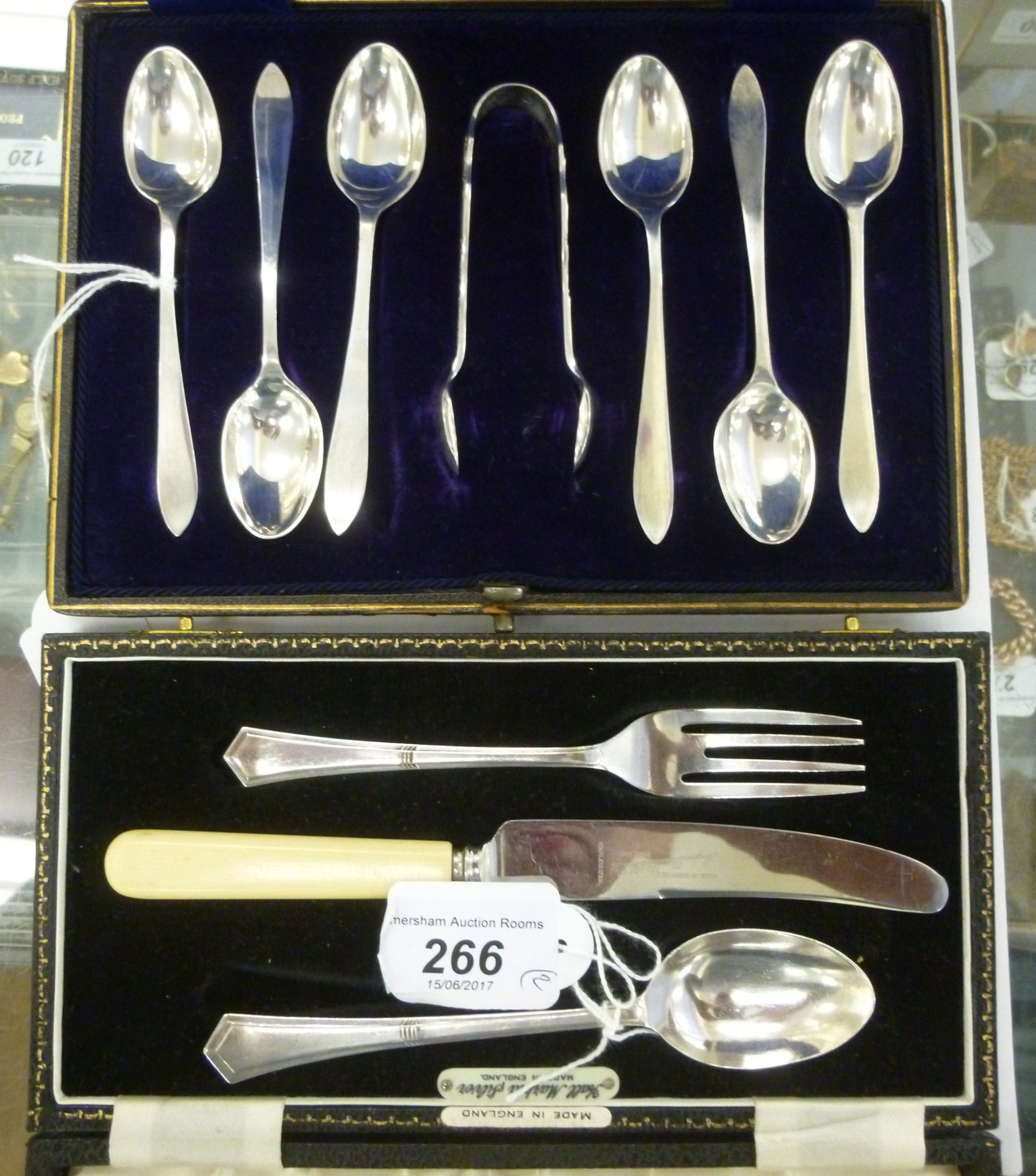 Lot 266 - A set of six silver coffee spoons and matched sugar tongs cased;
