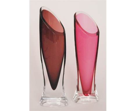 Two Paul Kedelv for Flygsfors post-war glass vases of compressed sleeve form, the first cased in clear crystal over amethyst,