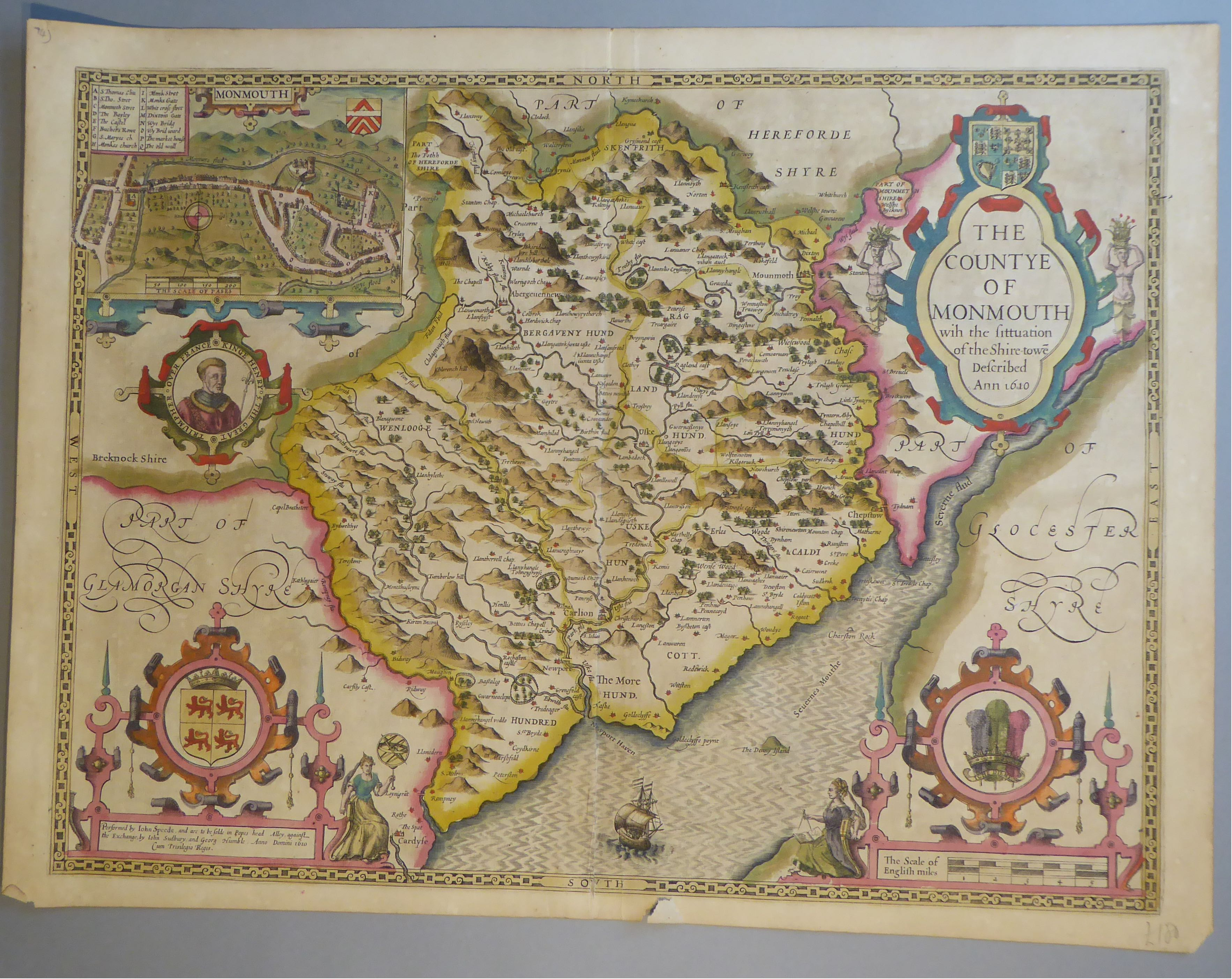 Lot 29 - A C17th hand coloured copper engraved map of The County of Monmouth by John Speed, c1612