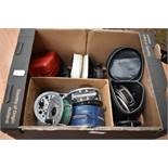 An assortment of fly reels, including J W Young, Shakespeare and Olympic 420