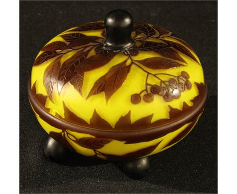 An Art Nouveau glass box and cover, in the manner of Galle, overlaid with leaves and berries
