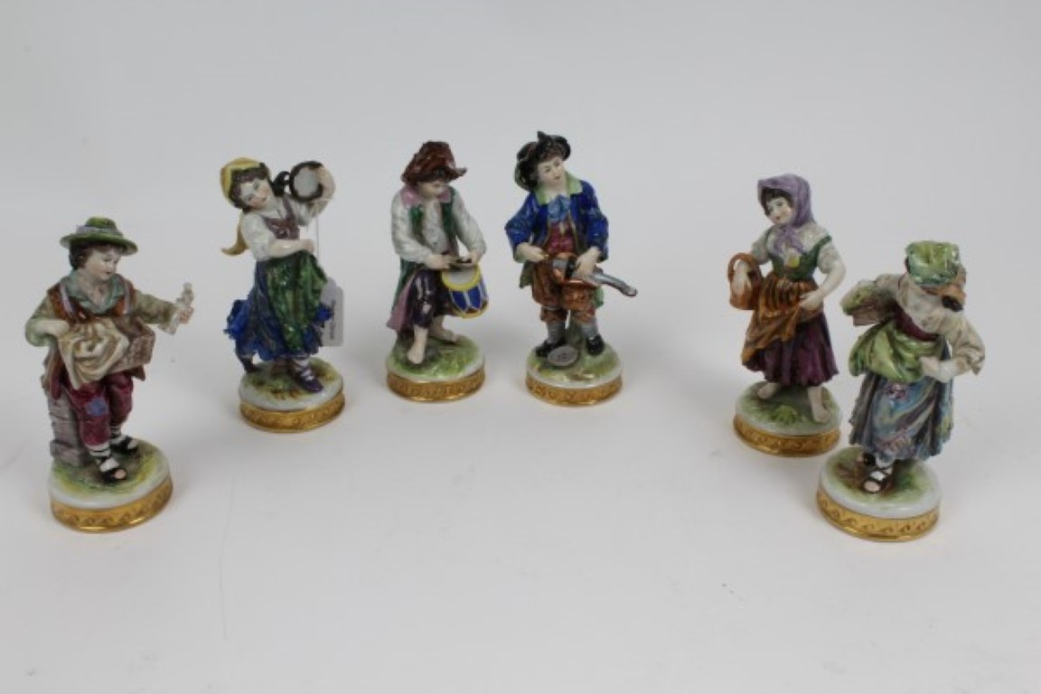 Lot 37 - Set of six early 20th century German Volkstedt porcelain figures of musicians with polychrome