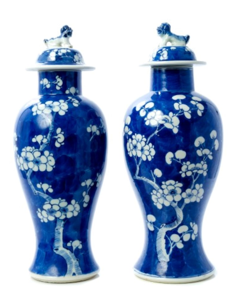 Lot 28 - Pair of early 20th century Chinese export blue and white oviform vases and covers with temple dog