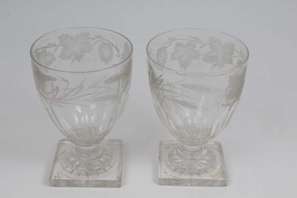 Lot 12 - Pair of Victorian slice cut rummers with engraved vine and hop decoration on knopped stem on square