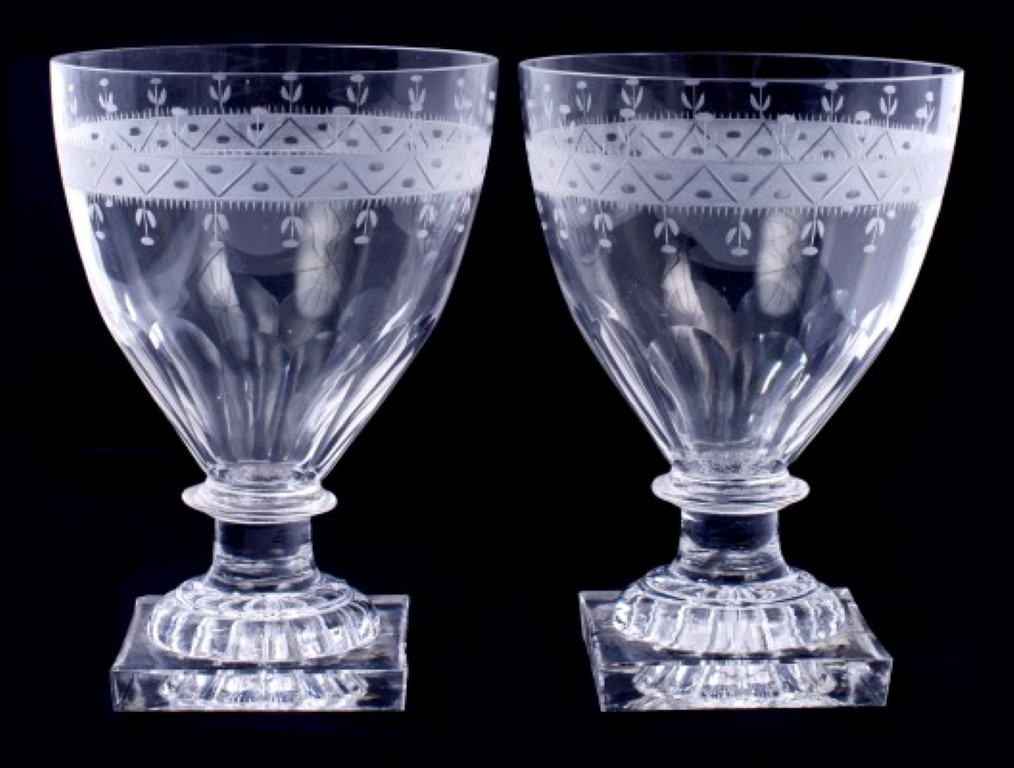 Lot 11 - Pair of Georgian glass rummers with etched bands and facet cut decoration, knopped stem on moulded