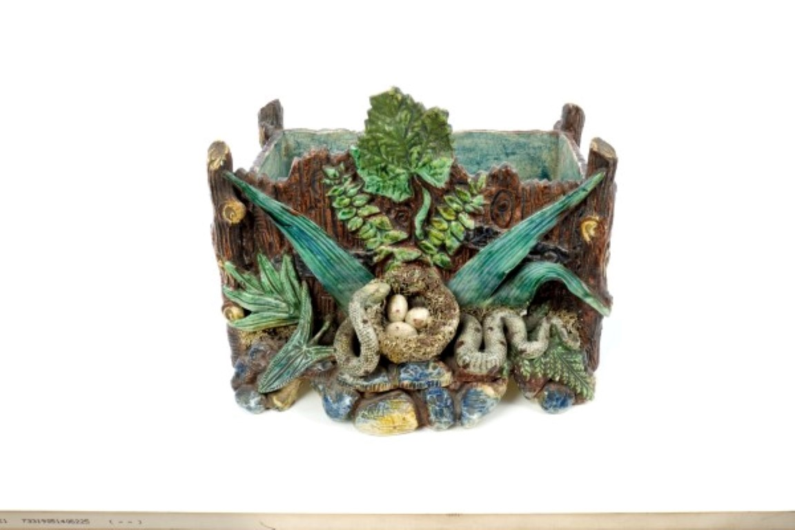 Lot 60 - Late 19th century Portuguese Palissy ware trough of rustic form, with snake stealing eggs from a