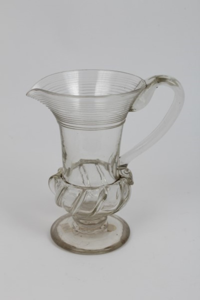 Lot 10 - Early 19th century glass jug with trailed decoration, loop handle, moulded body on knopped stem on