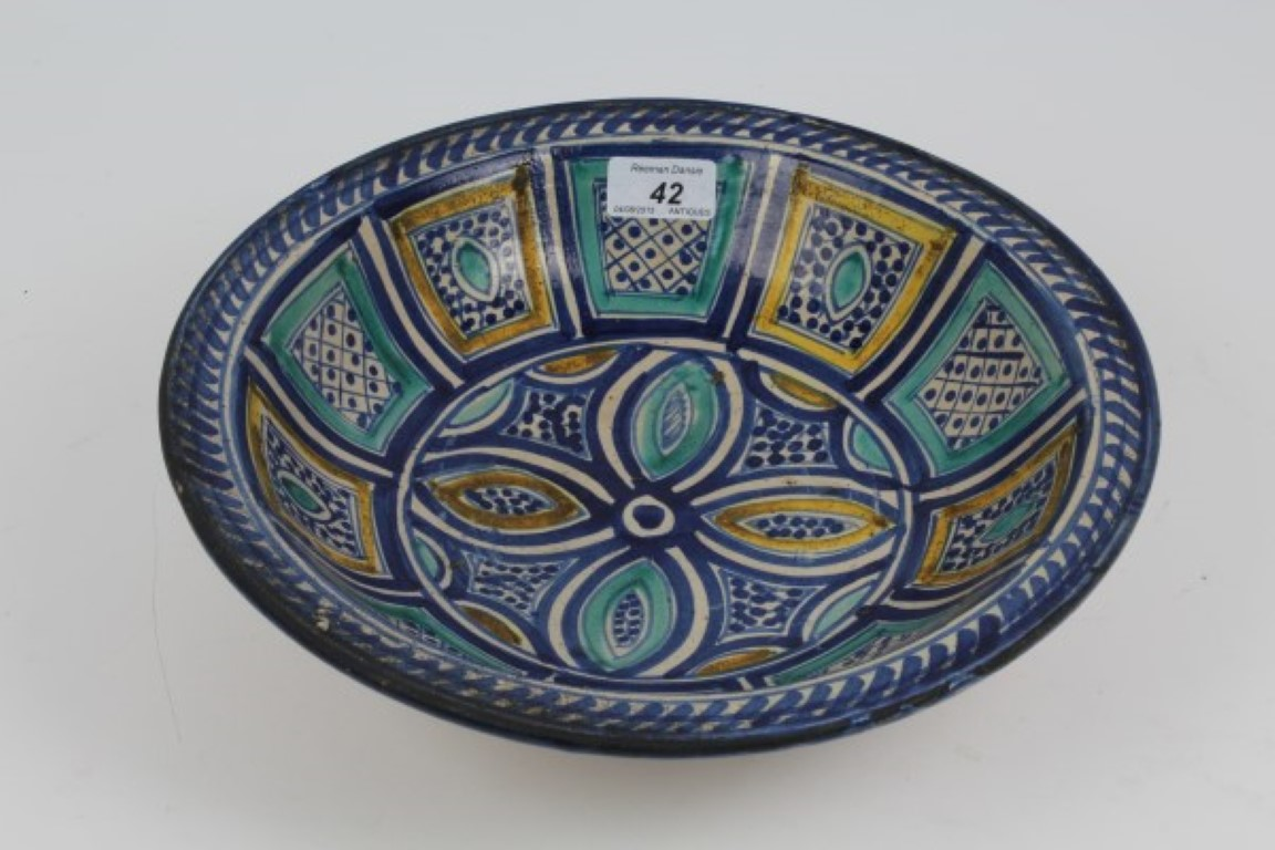 Lot 42 - Antique Spanish pottery dish with tin glazed geometric and stylised floral decoration on raised