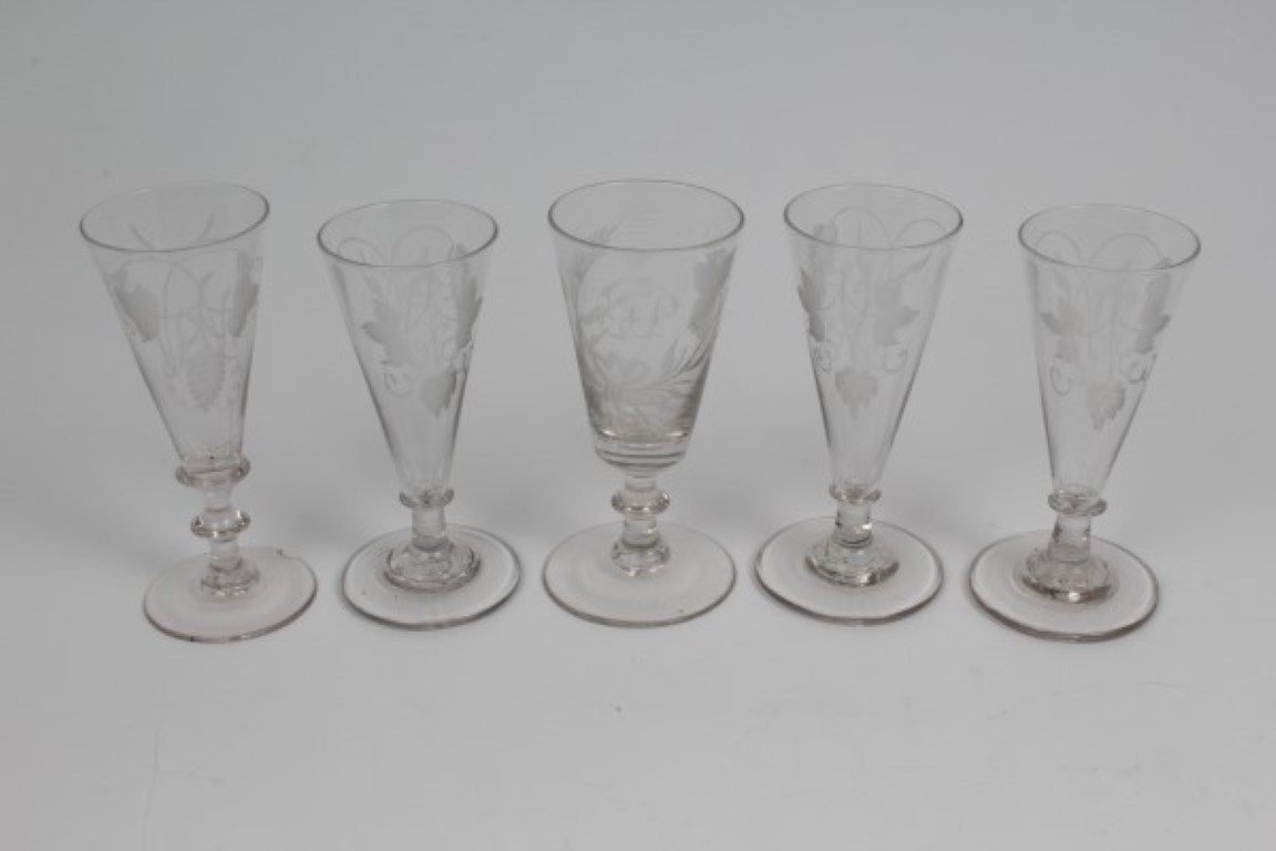 Lot 15 - Five Georgian ale flutes with engraved hop decoration, all on splayed foot,