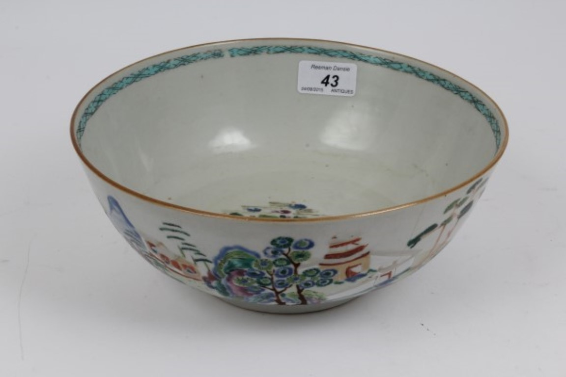 Lot 43 - 18th century Chinese famille rose porcelain punch bowl with polychrome painted buildings in