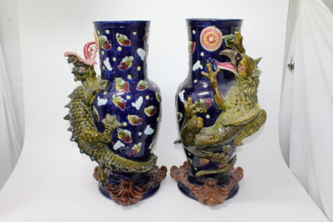 Lot 36 - Pair of impressive late 19th century Majolica vases with climbing dragon,