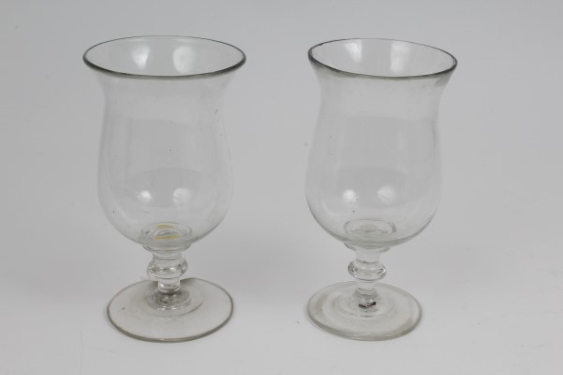 Lot 14 - Pair Georgian glass storm lamps with baluster bowls on knopped stems on splayed foot, 18.