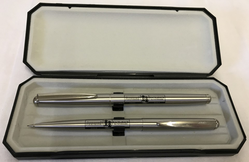 "Lot 36 - A cased 2002 - 3 Arsenal FC ""Back to Back"" FA cup winners pencil and pen set."