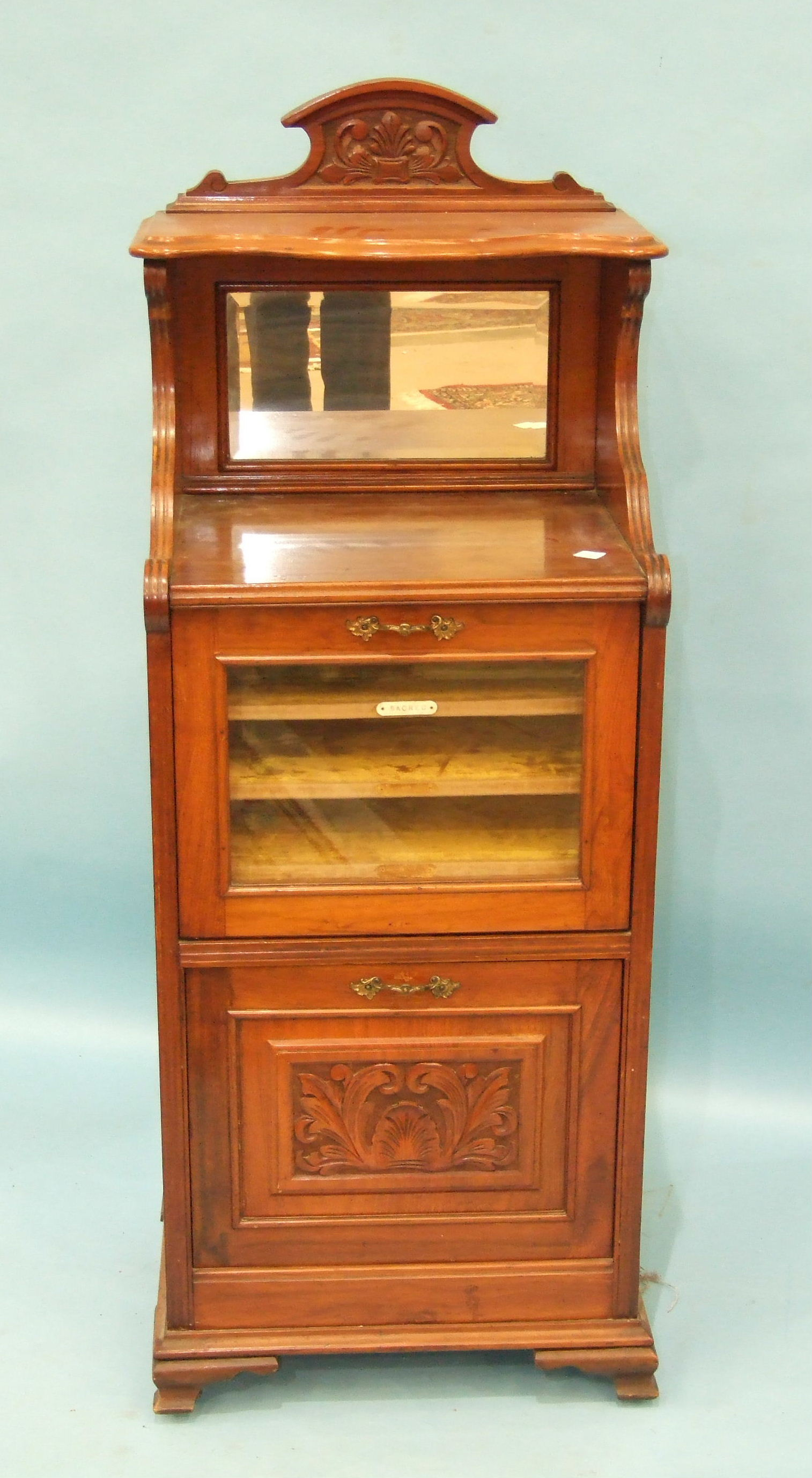 Lot 103 - A Victorian walnut music cabinet, the mirrored top above a glazed door and pull-down cupboard,