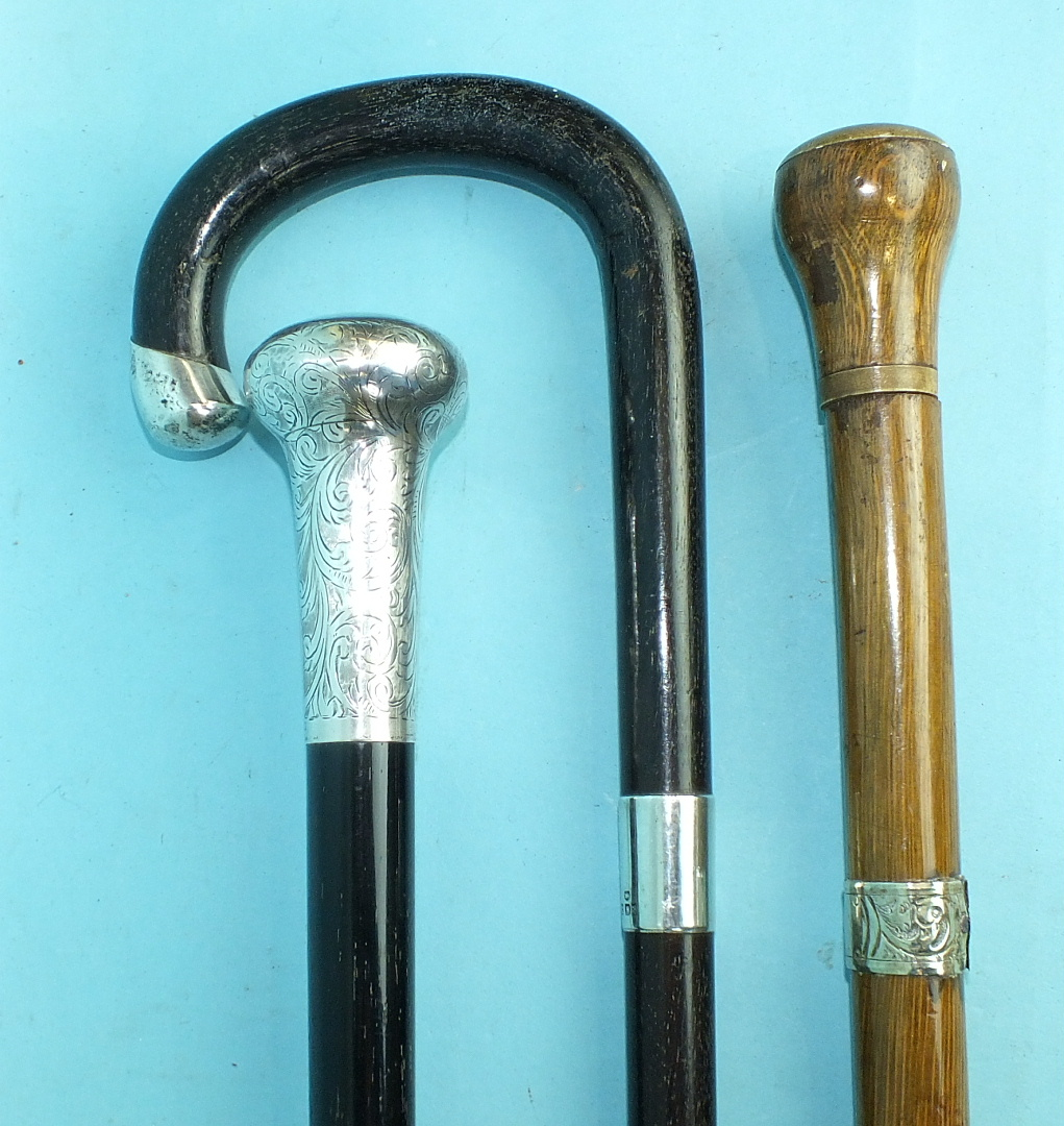 Lot 159 - A Victorian ebony walking cane with engraved silver button top and two other silver-mounted