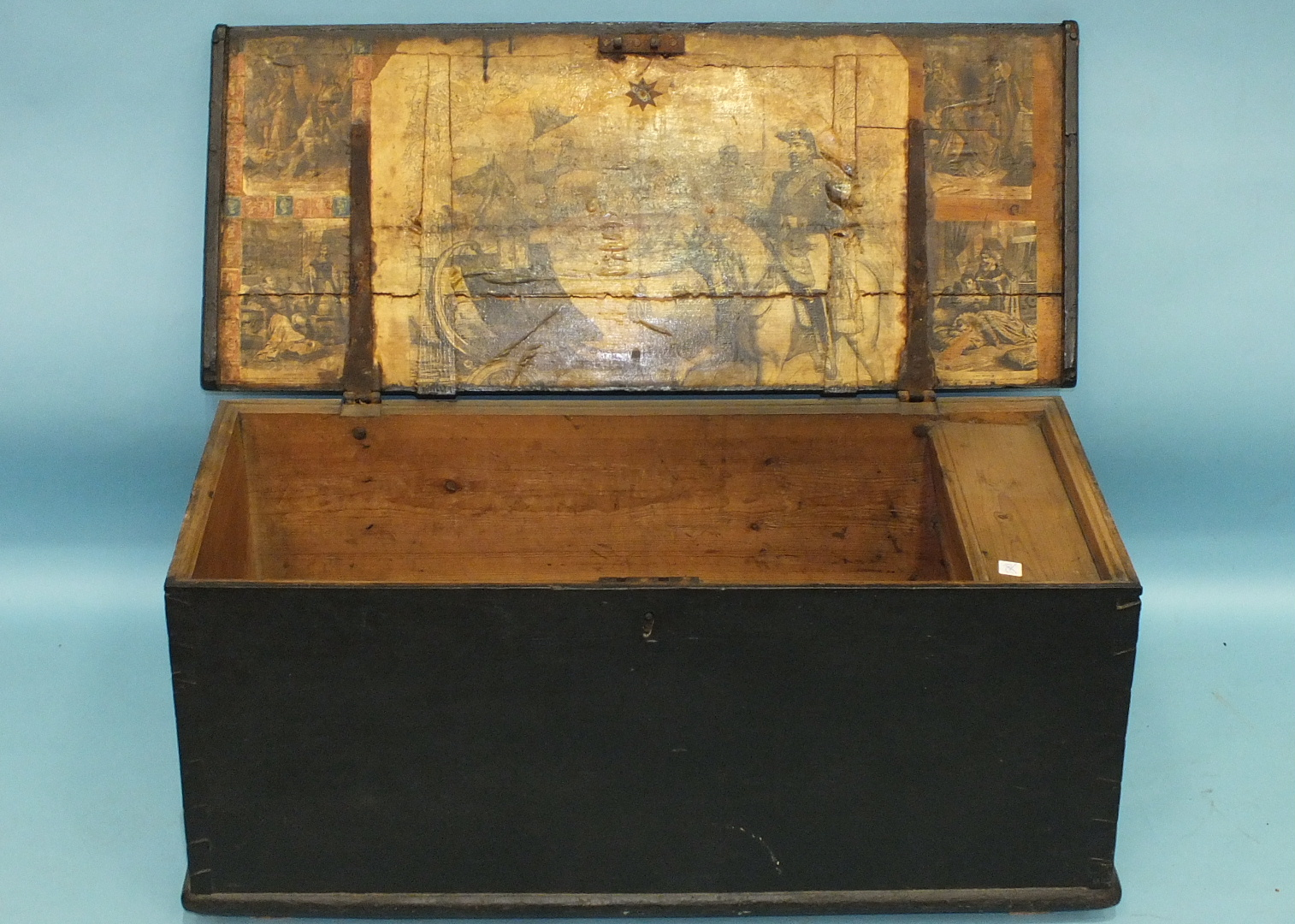 Lot 107 - A 19th century stained pine lidded box of rhomboid shape, the hinged lid opening to reveal a collage