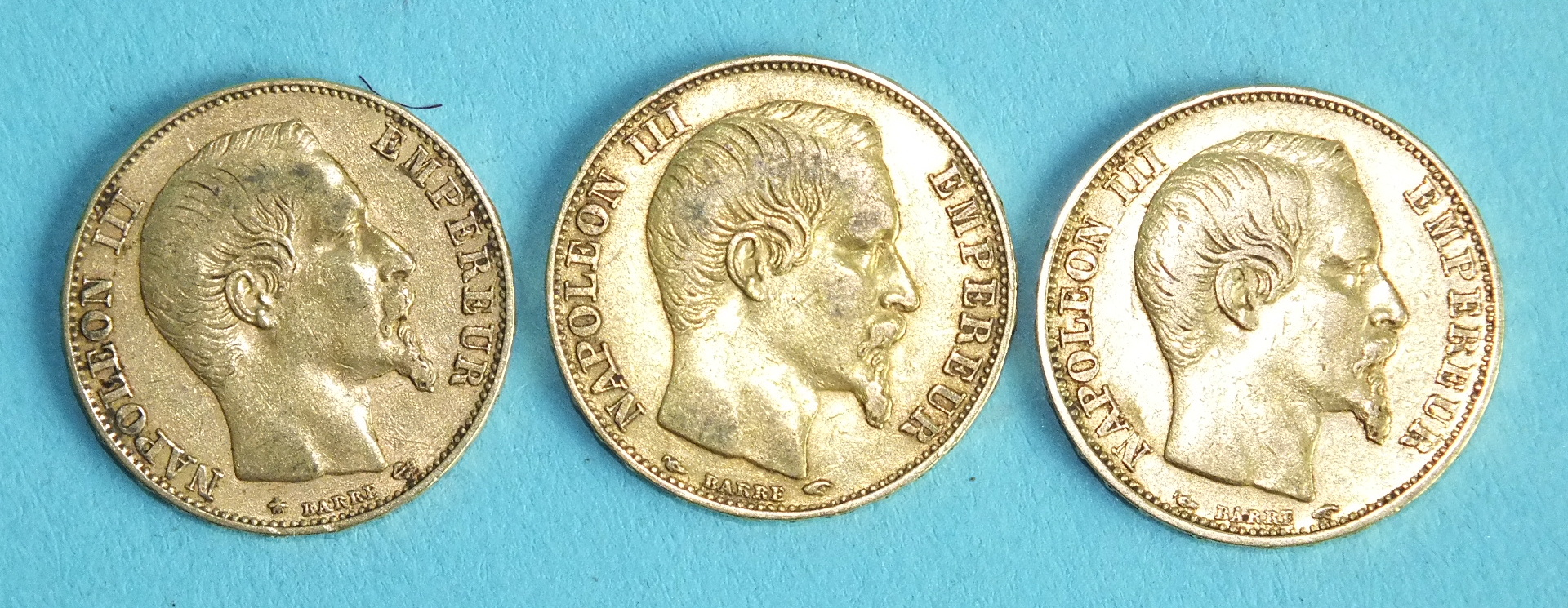 Lot 386 - Three French Napoleon III 20-Francs coins, 1853, 1855 (x2), (3).