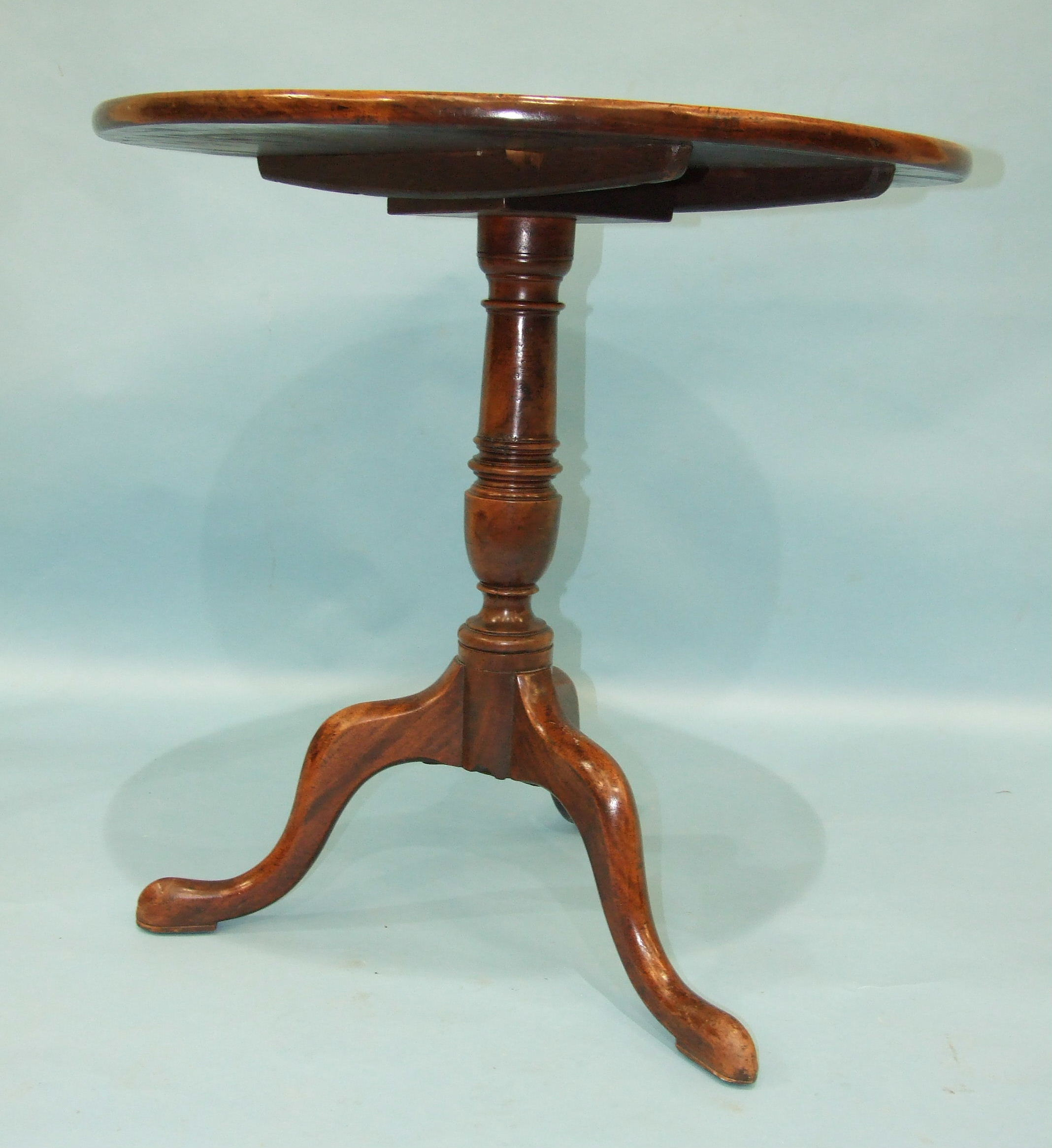 Lot 70 - A Georgian mahogany circular tilt-top table with turned stem and cabriole tripod, 72cm diameter, (