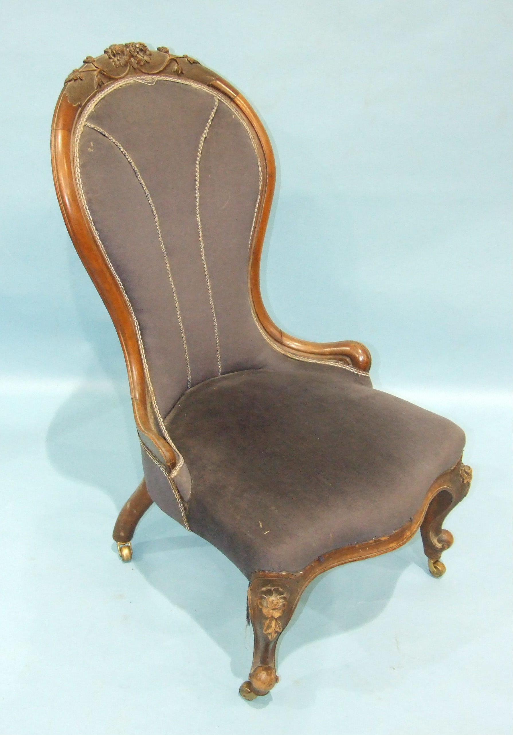 Lot 98 - A Victorian walnut spoon-back nursing chair, the frame carved with flowers and with serpentine seat,