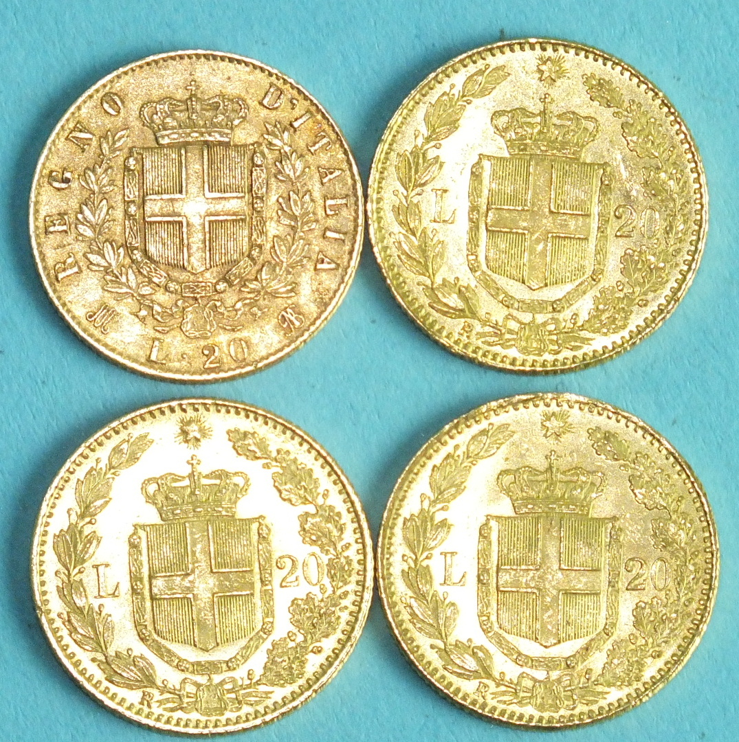Lot 389 - Three Italian Kingdom Umberto I 20-Lire coins, 1882 and a Vittorio Emanuelle 20-Lire coin, 1873, (
