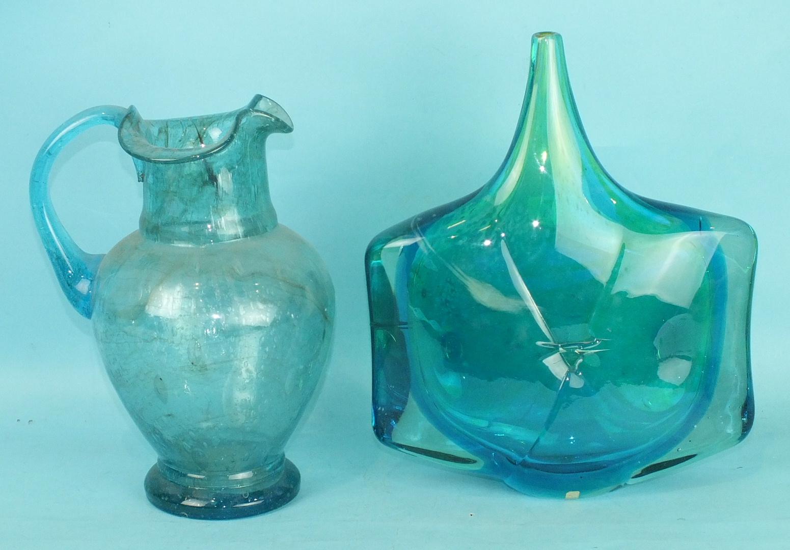 Lot 210 - A Victorian bubble glass jug, pale blue colour, 27cm high and a 1960's mottled blue studio glass